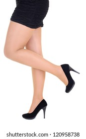 beautiful female legs in black shoes over white