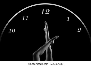 beautiful female legs in dance moves like the hands of a Christmas hours on black background