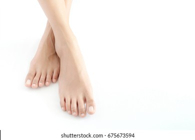 Beautiful female legs and feet on a white background.