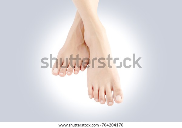 Beautiful female legs and feet skin white on pink background.Beauty and fashion concepts