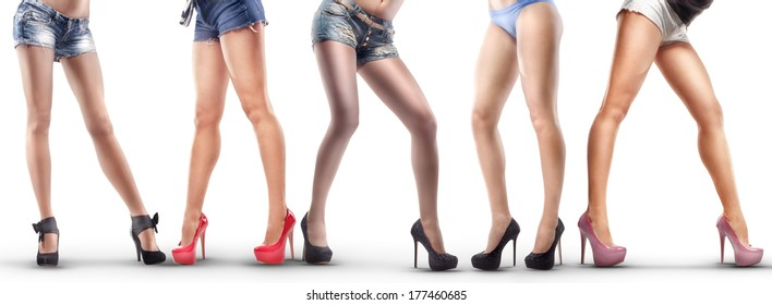 Lot of beautiful female legs isolated on white background. High resolution