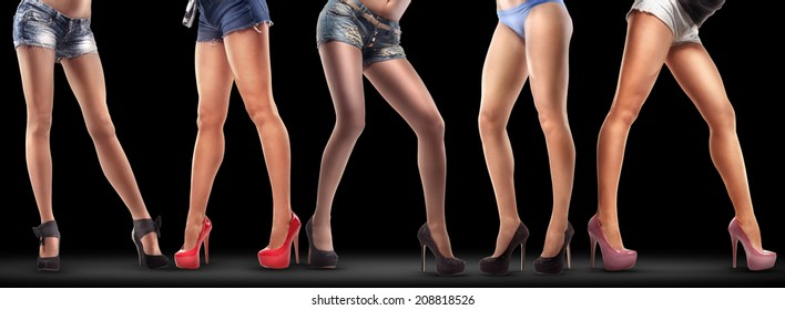 Lot of beautiful female legs isolated on black background. High resolution