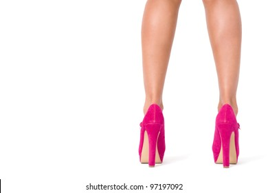 Beautiful female legs in pink shoes