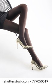Beautiful female legs. Shapely female legs in pantyhose and high heels.