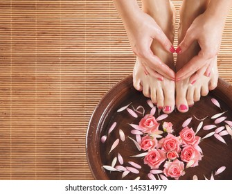 Beautiful female legs in spa composition