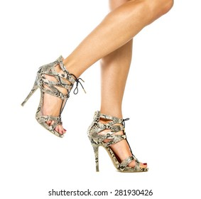 Beautiful female legs in strappy high heels shoes with small platform sole and ankle straps, animal print design,  XXL image