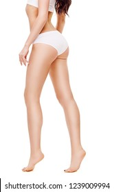 beautiful female legs with white panties on white background