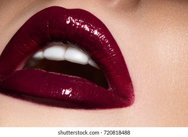 Beautiful female lips with burgundy makeup close-up