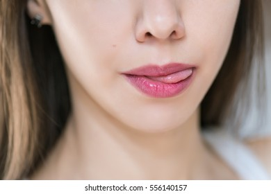 Beautiful female lips, close up. Selective focus.
