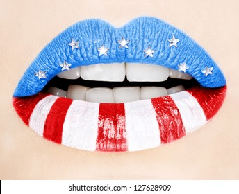 Beautiful female lips painted with American flag,macro photography