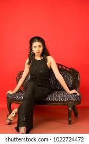 beautiful female model in black gown