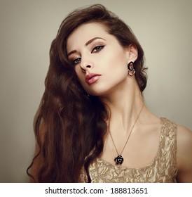 Beautiful female model with long hair posing. Closeup portrait