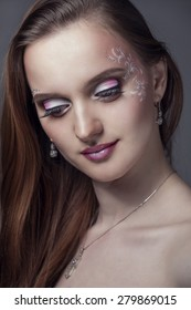 Beautiful female model posing on gray background