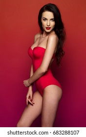 Beautiful female model posing on red background