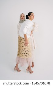 Beautiful female model wearing Baju Kurung (traditional Malay dress) and scarf isolated over white background.Fashion for Muslim Female.