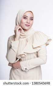 "Beautiful female model wearing bright color ""baju kurung"" dress with hijab, a modern lifestyle outfit  for Muslim woman isolated over white background. Eidul fitri fashion and beauty concept."