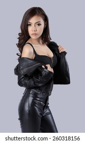beautiful female model wearing a leather dress - in studio
