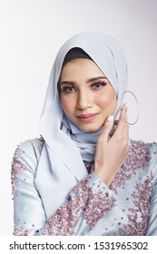 Beautiful female model wearing light blue peplum dress with hijab, a modern lifestyle outfit for wedding ceremony isolated over white background. Malay wedding dress concept.