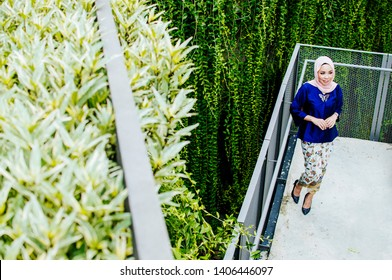 Beautiful female model wearing peplum dress and kebaya with hijab  a modern lifestyle outfit for Muslim woman isolated over white background. Eidul fitri fashion and beauty concept.