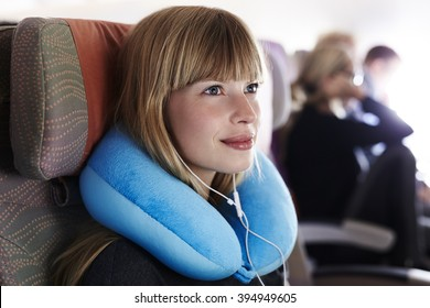 Beautiful female passenger on airplane