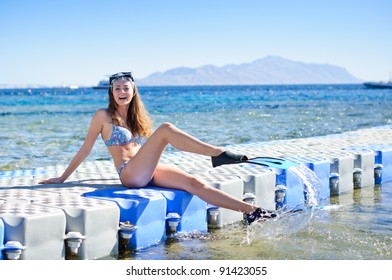 Beautiful female portrait on the beach wearing snorkeling equipment, water sport, healthy lifestyle concept