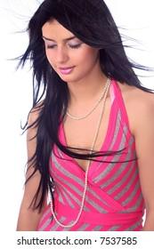 Beautiful female in rose dress