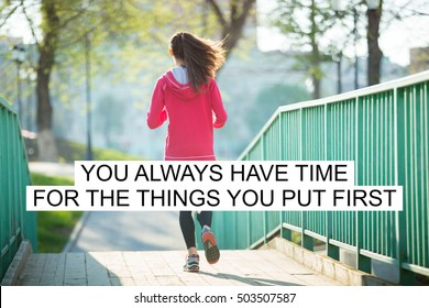 """Beautiful female running on the bridge during everyday practice. Fitness woman jogging in park. Sport active lifestyle concept. Motivational text """"You always have time for the things you put first"""""""