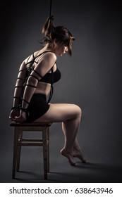 beautiful female slave sitting bondage ropes on chair