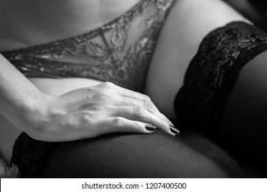 beautiful female slim body in panties and stockings closeup, monochrome