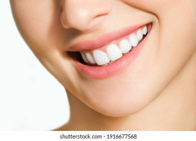 Beautiful female smile after teeth whitening procedure. Dental care. Dentistry concept.