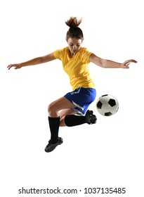 Beautiful female soccer player kicking ball with heel over white background