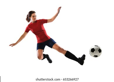 Beautiful female soccer player sliding to kick ball isolated over white background