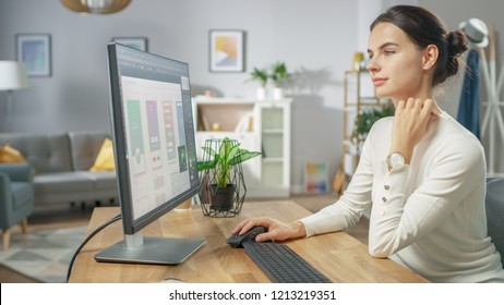 Beautiful Female Software Designer Works on a UX / UI Mobile App Template, Uses Personal Computer. Freelance Programmer Working from Home. Mock-up App Design.