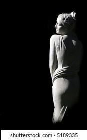Beautiful Female Statue on black background