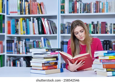 beautiful female student learning in the library