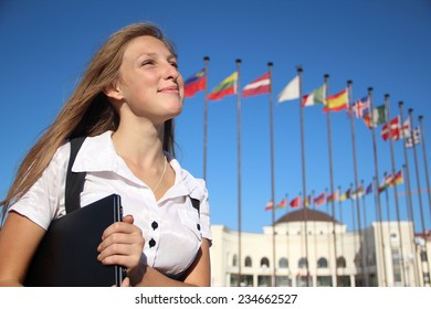 beautiful female student on the background of international flags