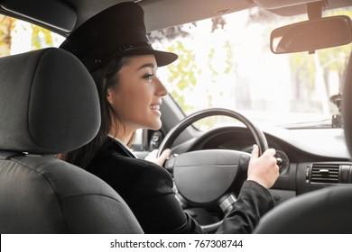 Beautiful female taxi driver in car