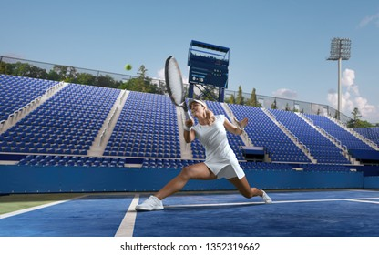 Beautiful female tennis player serving outdoor on professional tennis court.
