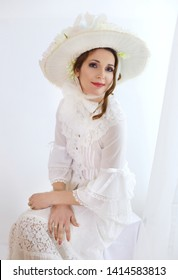 beautiful female in victorian or edwardian age hat and  dress