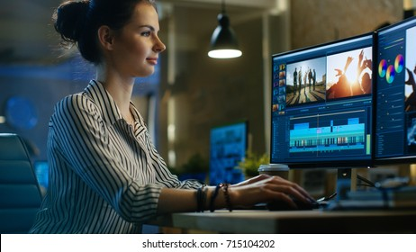 Beautiful Female Video Editor Works with Footage on Her Personal Computer, She Works in Creative Office Studio.