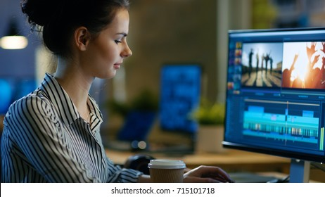 Beautiful Female Videographer Edits Footage on Her Personal Computer, She Works in Creative Office Space Late at Night.