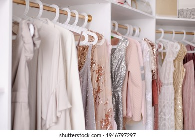 Beautiful female wardrobe. A lot of party dresses hanging on hangers in closet. Vintage clothing rental concept. Women's space. Large selection of various clothes. Small boutique showroom fashion shop - Shutterstock ID 1946797297