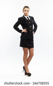 beautiful female young airline pilot full height on light background