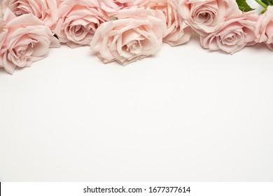 Beautiful feminine floral flat lay fresh rose background
