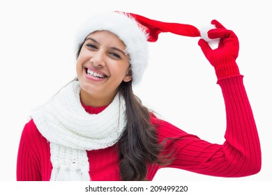 Beautiful festive woman smiling at camera on white background