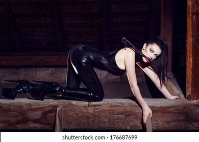 Beautiful fetish model kneeling in cat pose, seduction