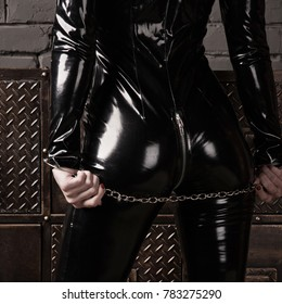 Beautiful fetish model in latex costume. BDSM concept