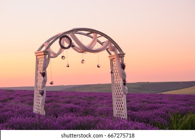 Beautiful field of blooming lavender with wedding wood decoration in the summer
