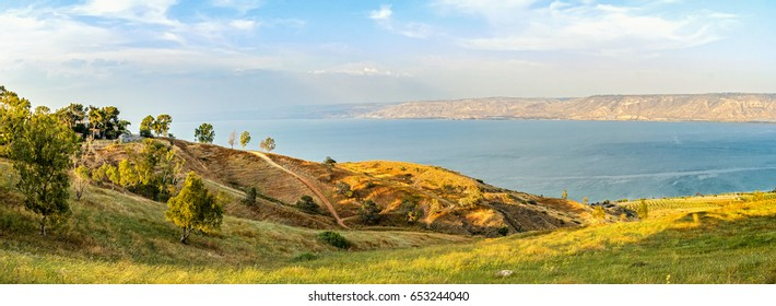 Beautiful fields and mountains around the Sea of Galilee (Kinneret) at sunset. Lake in the Galilee mountains in north of Israel.