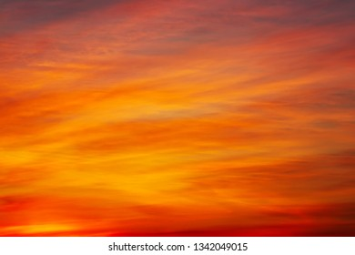 Beautiful fiery, orange and red, sunset sky. Evening Magic Scene. Composition of nature